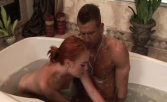 redhead masseuse sucking cock in the bathtub