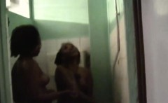 Nelly and Natasha strip and go under shower together. They