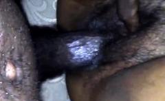Ebony chick fingering her hairy pussy
