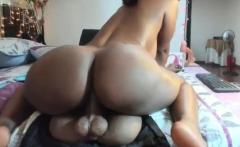 Busty ebony toys her ass