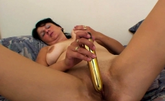 MILF moans while playing with a dildo