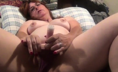 Mature brunette goes solo and toys her pussy