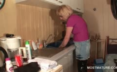 Mature housekeeper teasing her hot snatch in the kitchen
